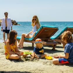 Kids Staying At The Amathus Hotel Beach
